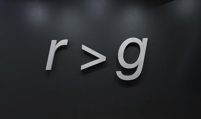 Artwork of grey letters on black background