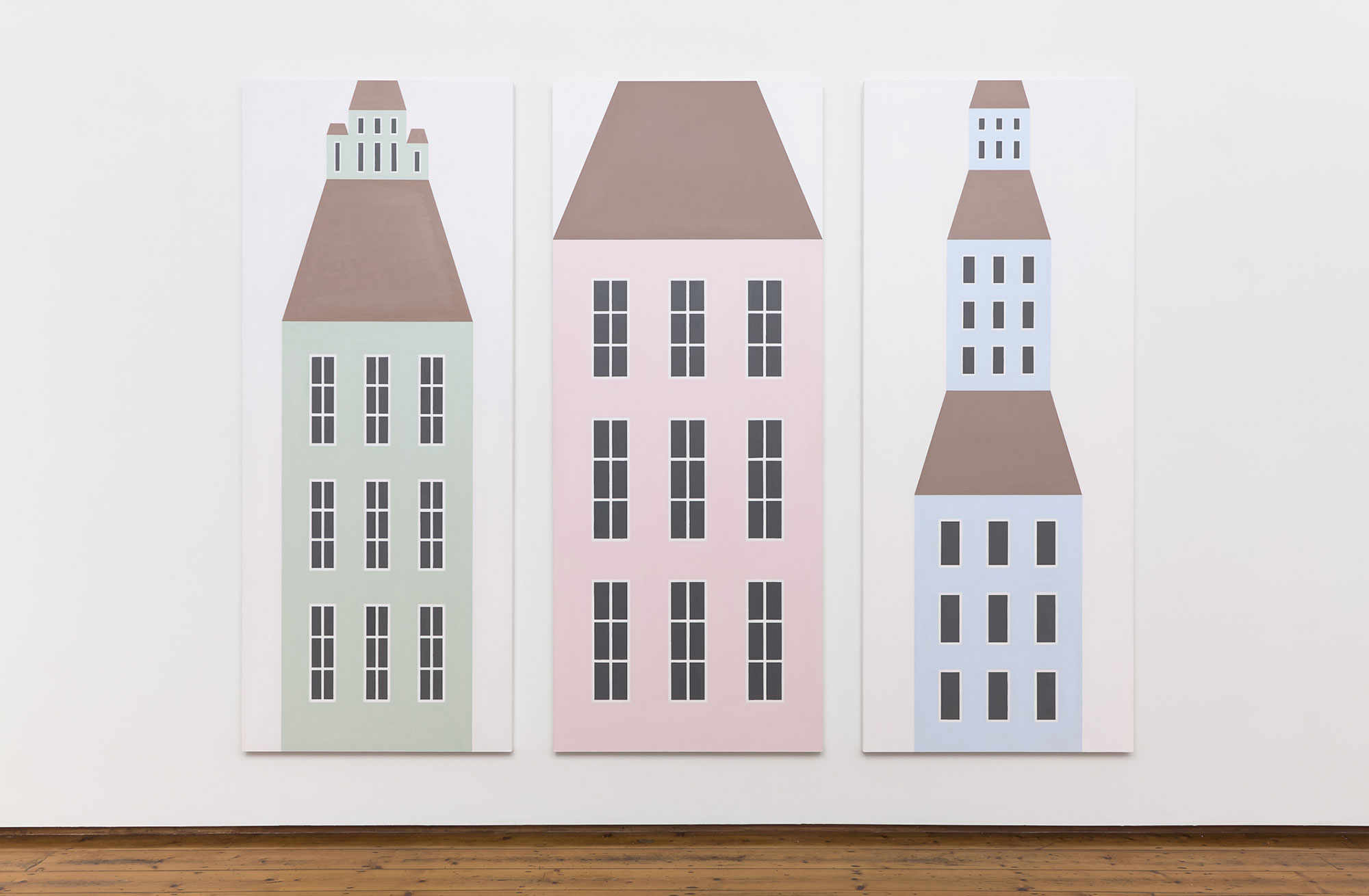 3 hand-drawn pastel townhouses