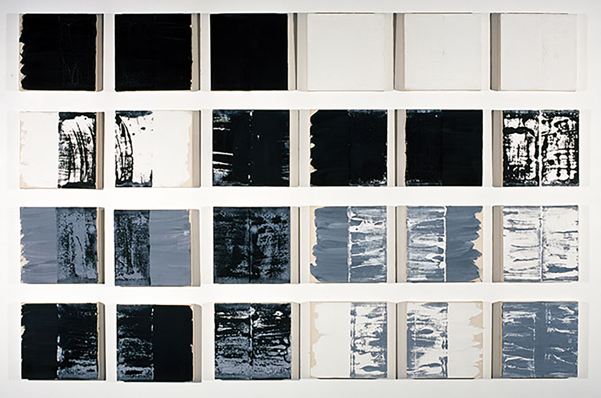 Painting of 24 squares with shades of black, blue/black, blue/white, blue/black