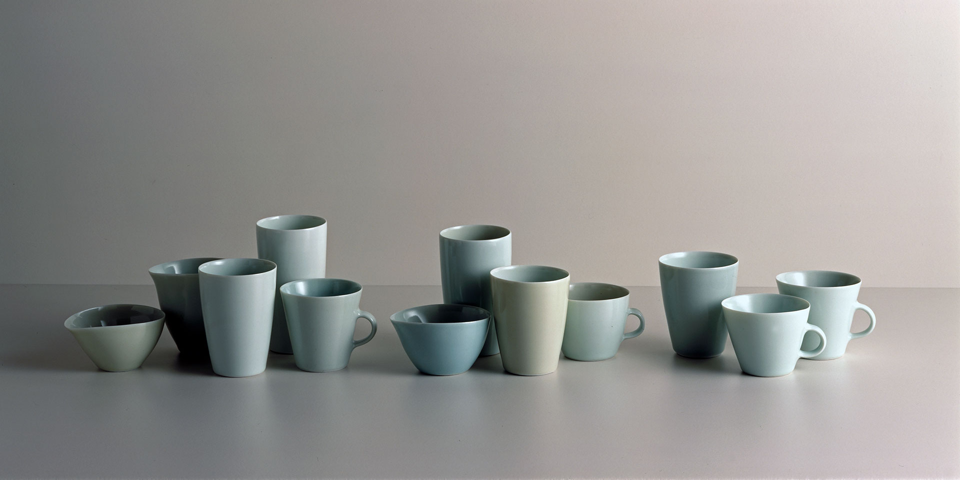 Gwyn Hanssen Pigott 'Pale suite with cups' 2001 | twelve glazed, wood fired porcelain vessels, wheel thrown | QUT Art Collection | Purchased 2001