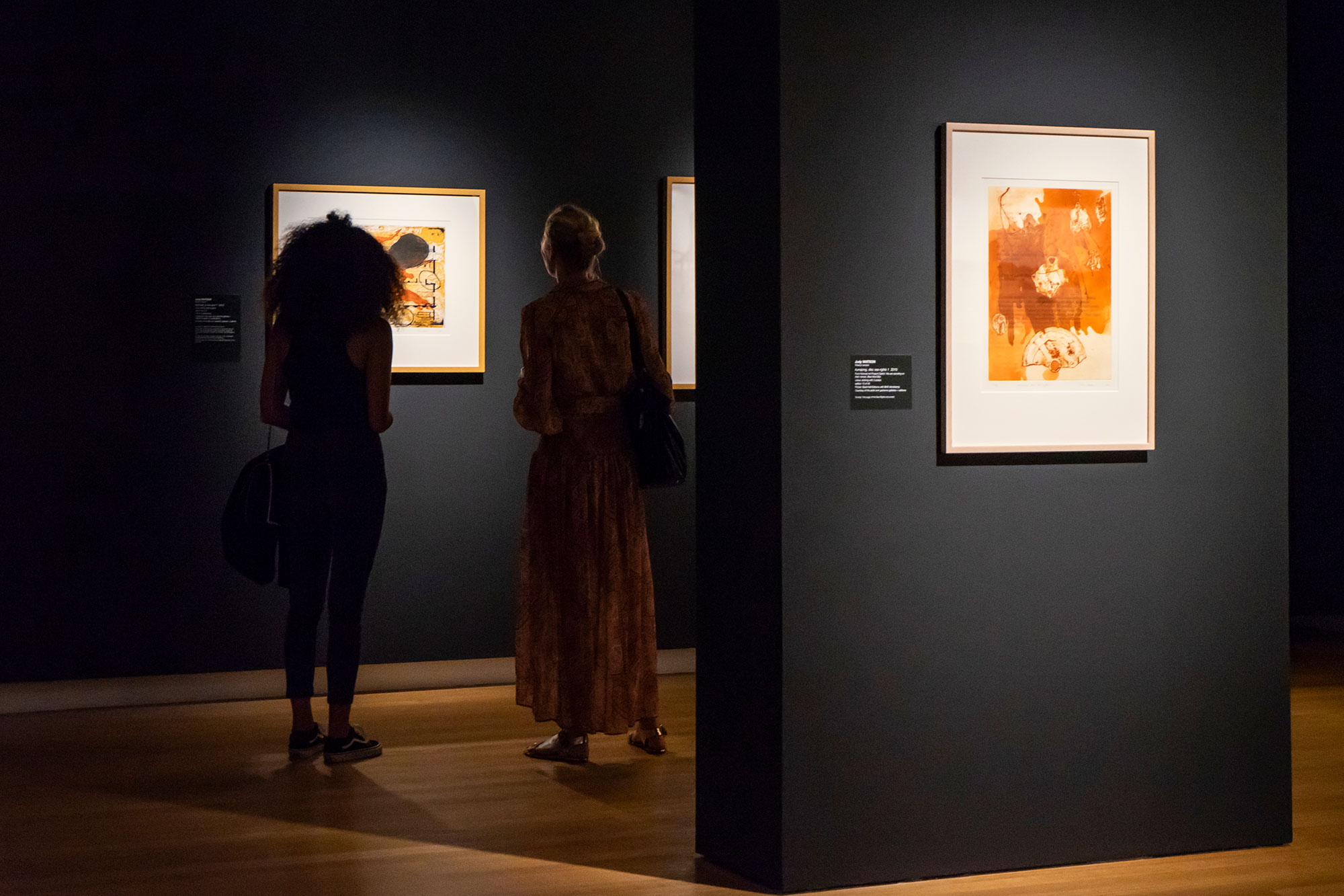 2 people analysing art at qut art museum