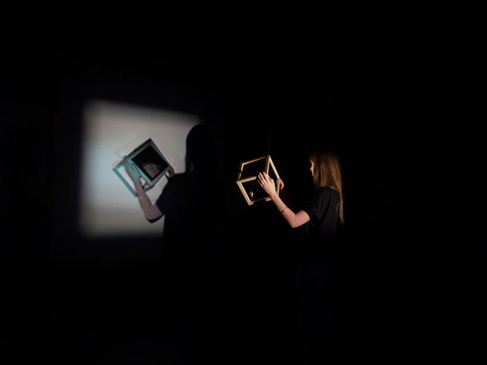 Caitlin FRANZMANN 'Light render' 2012 | double projection, live video feed, timber, mirror | Courtesy of the artist
